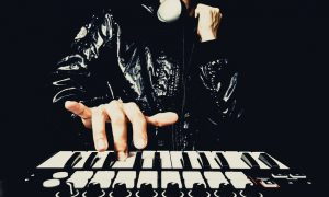 professional musician or DJ hand on studio keyboard synthesizer, isolated on black for dance , groove, remix, underground music background concept